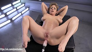 dildo machine satisfies her wet MILF pussy