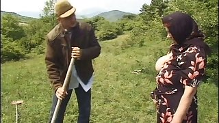German granny strips to be fucked by a younger dude in outdoors
